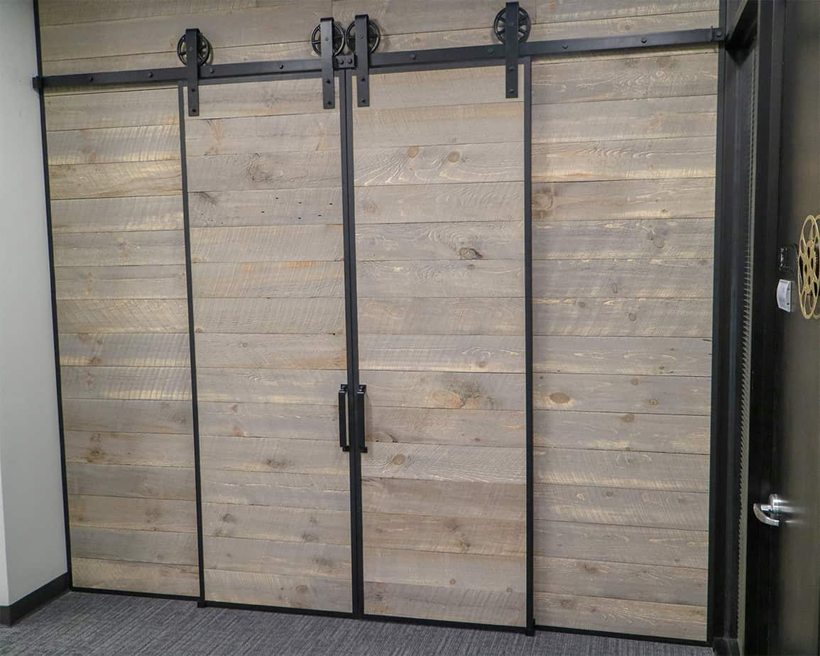 biparting sliding doors with barn door edge wrap