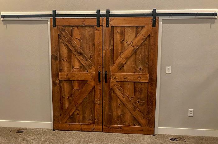 biparting sliding doors with Goldberg Brothers barn door hardware